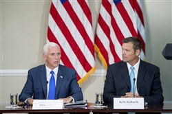 In this July 19, 2017 file photo, Vice President Mike Pence, left, accompanied by Vice-Chair Kris Kobach, right, speaks during the first meeting of the Presidential Advisory Commission on Election Integrity at the Eisenhower Executive Office Building on the White House complex in Washington.
