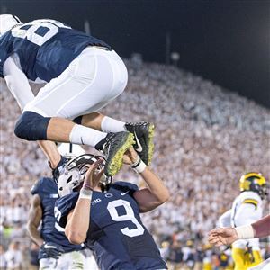 Penn State's Mike Gesicki jumps over Trace McSorley after McSorley scored a touchdown against Michigan on Saturday, Oct. 21, 2017 at Beaver Stadium.