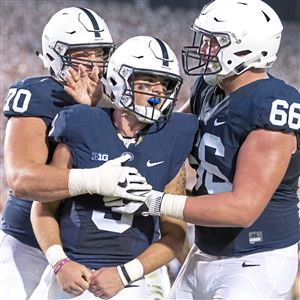 Penn State's Trace McSorley celebrates after scoring a touchdown during the Penn State vs. Michigan game on Saturday, Oct. 21, 2017 at Beaver Stadium.