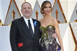 Harvey Weinstein, left, and Georgina Chapman attend the 89th Annual Academy Awards at the Dolby Theatre in Los Angeles on February 26, 2017.