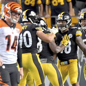 Steelers teammates congratulate Bud Dupree on a sack on Bengals quarterback Andy Dalton in the fourth quarter at Heinz Field Sunday, October 22, 2017 in Pittsburgh.