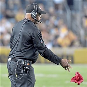 Bengals head coach Marvin Lewis throws a challenge flag against the Steelers in the fourth quarter at Heinz Field Sunday, October 22, 2017 in Pittsburgh.