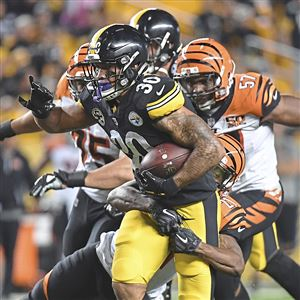 Pittsburgh Steelers James Conner picks up yardage against the Bengals late in the fourth quarter Sunday, October 22, 2017, at Heinz Field, Pittsburgh.
