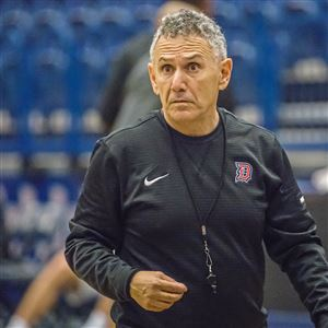 Duquesne coach Keith Dambrot keeps an eye on practice Monday at A.J. Palumbo Center.