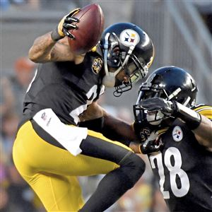 Safety Sean Davis, right, was the Steelers' highest rated player in the win against the Cincinnati Bengals Sunday at Heinz Field.