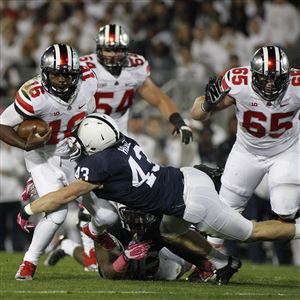 Penn State's Mike Hull tackles Ohio State's J.T. Barrett in the first half of the 2014 game between the Big Ten rivals in State College. Penn State announced Saturday night that ESPN will bring its College Gameday show to State College on Sept. 29 prior to this year's Ohio State game that night.