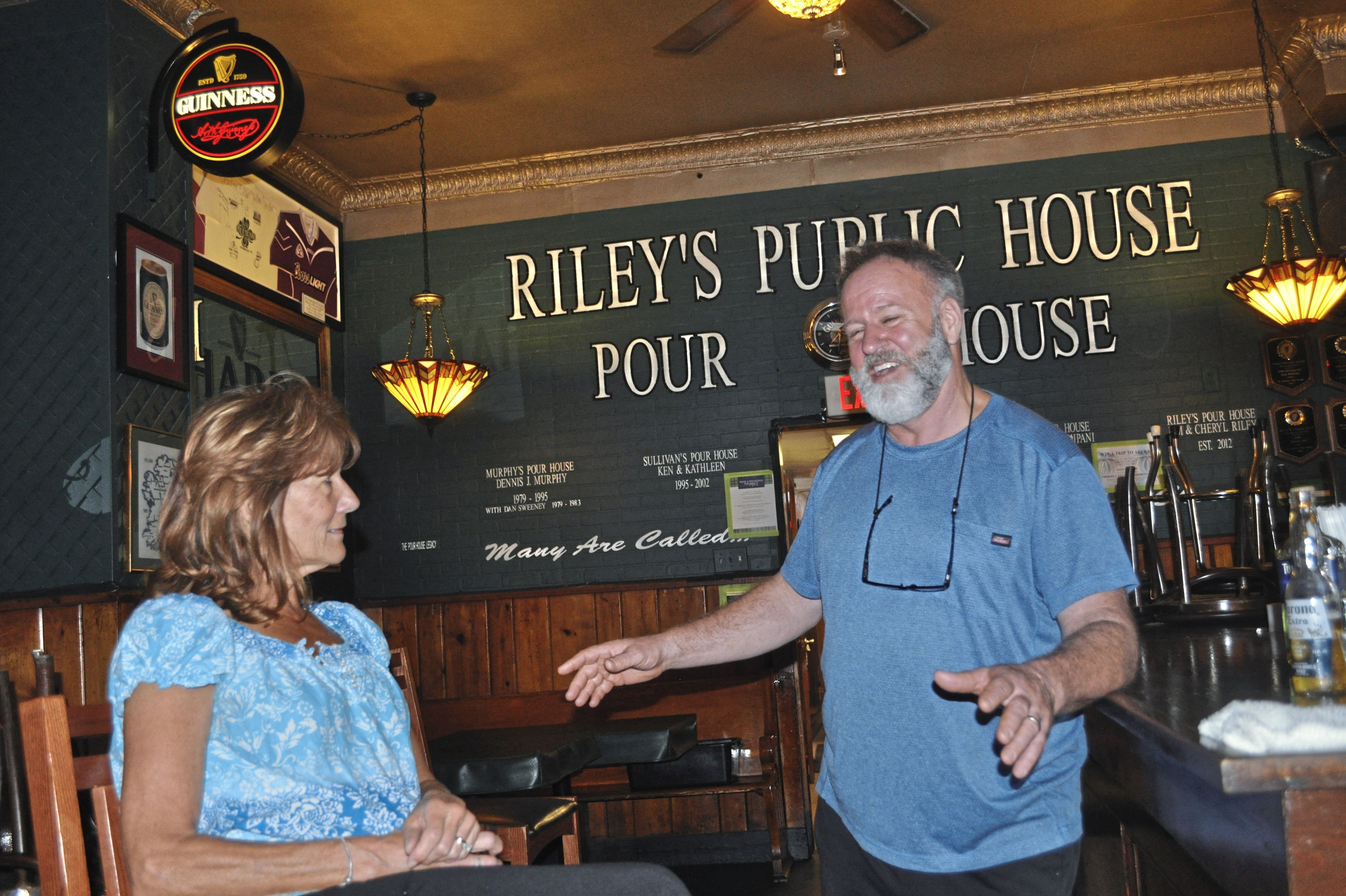 Distinction_pourhouse_dist2 Jim and Cheryl Riley share a laugh when recounting stories of their bar and restaurant, Riley's Pour House, on East Main Street in Carnegie.