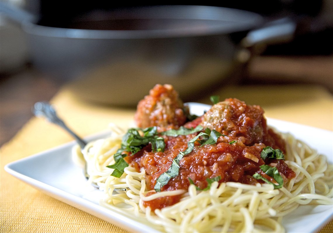 Turkey Meatballs Flavored With Pesto And Served Along With Spaghetti.