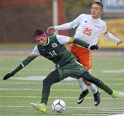 Seton-LaSalle's Tyler Stack (14) battles Springdale's Nicholas Taliani in WPIAL Class 1A boys soccer semifinal match Saturday at North Allegheny High School.