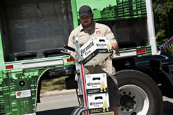In this file photo, a worker loads cases of Constellation Brands' Corona beer onto a cart for delivery in Ottawa, Illinois, on June 27, 2017.