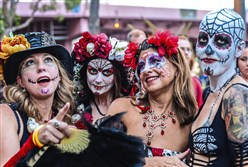 In this November 2013 photo, four women in costumes celebrate in the Day of the Dead Parade in Fort Lauderdale, Fla.