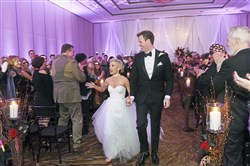 Maggie Carr and Billy Hepfinger III are all smiles down the aisle after their ceremony at the Westin Hotel, Downtown.