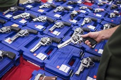 This file photo shows the Nation's Gun Show at the Dulles Expo Center in Chantilly, Va., in October 2015.