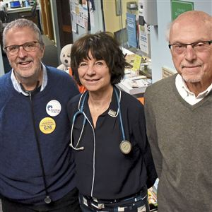 Drs. Scott Tyson and Ana Malinow with Ed Grystar, left to right, in the waiting room of Dr. Tyson's office in Robinson.