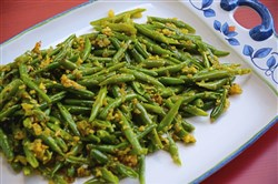"Green beans is spiced with green chili and red pepper flakes in the recipe from the cookbook, ""Rasika."""
