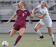 Greensburg Central Catholic's Brenna Springer and Shady Side Academy's Krystyna Rytel go for the ball at Highmark Stadium, November 02, 2017 in Pittsburgh. (Matt Freed/Post-Gazette)