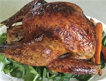A whole roasted turkey with plum glaze.