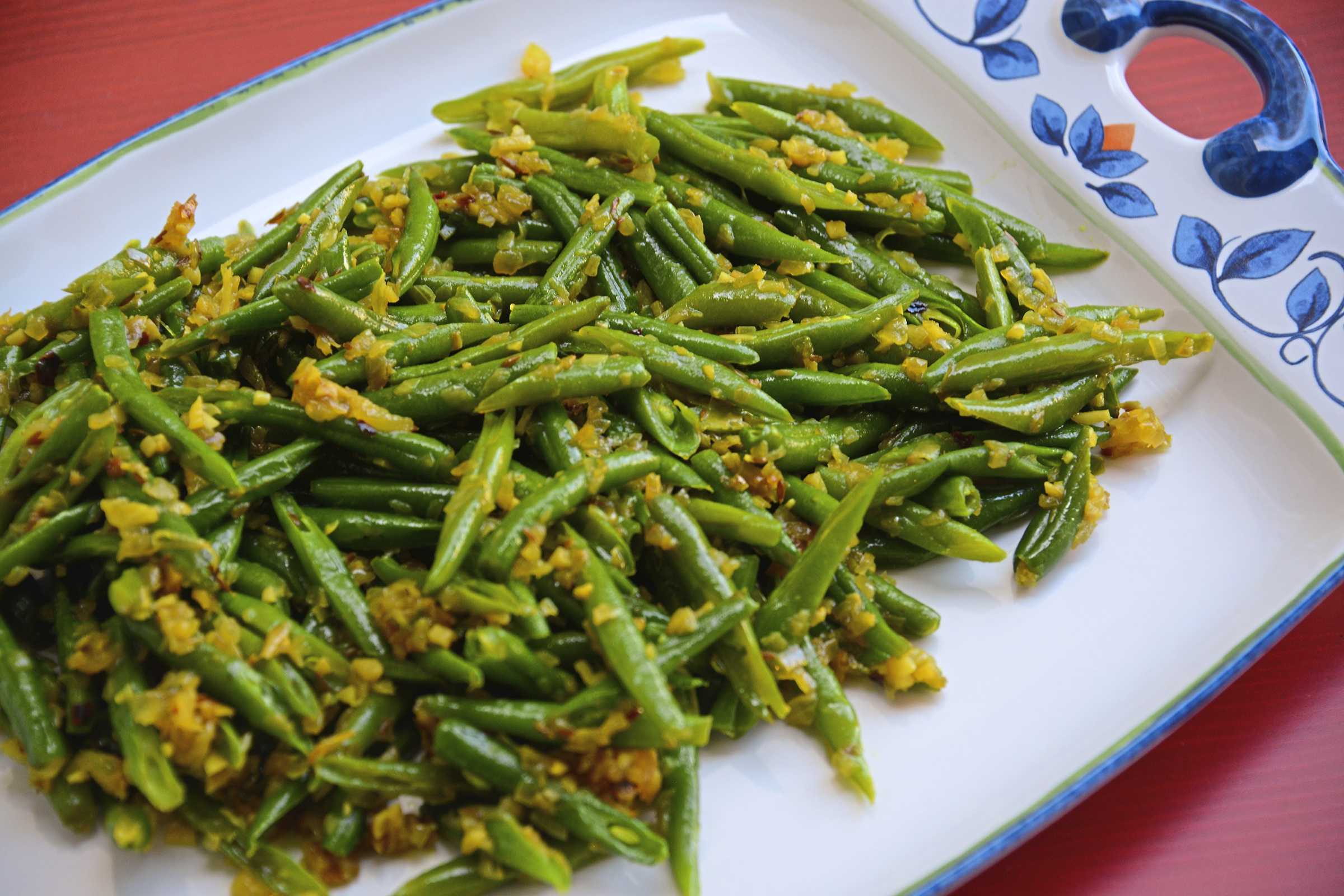 "20171101lf-Thanksgiving01 Green beans is spiced with green chili and red pepper flakes in the recipe from the cookbook, ""Rasika."""