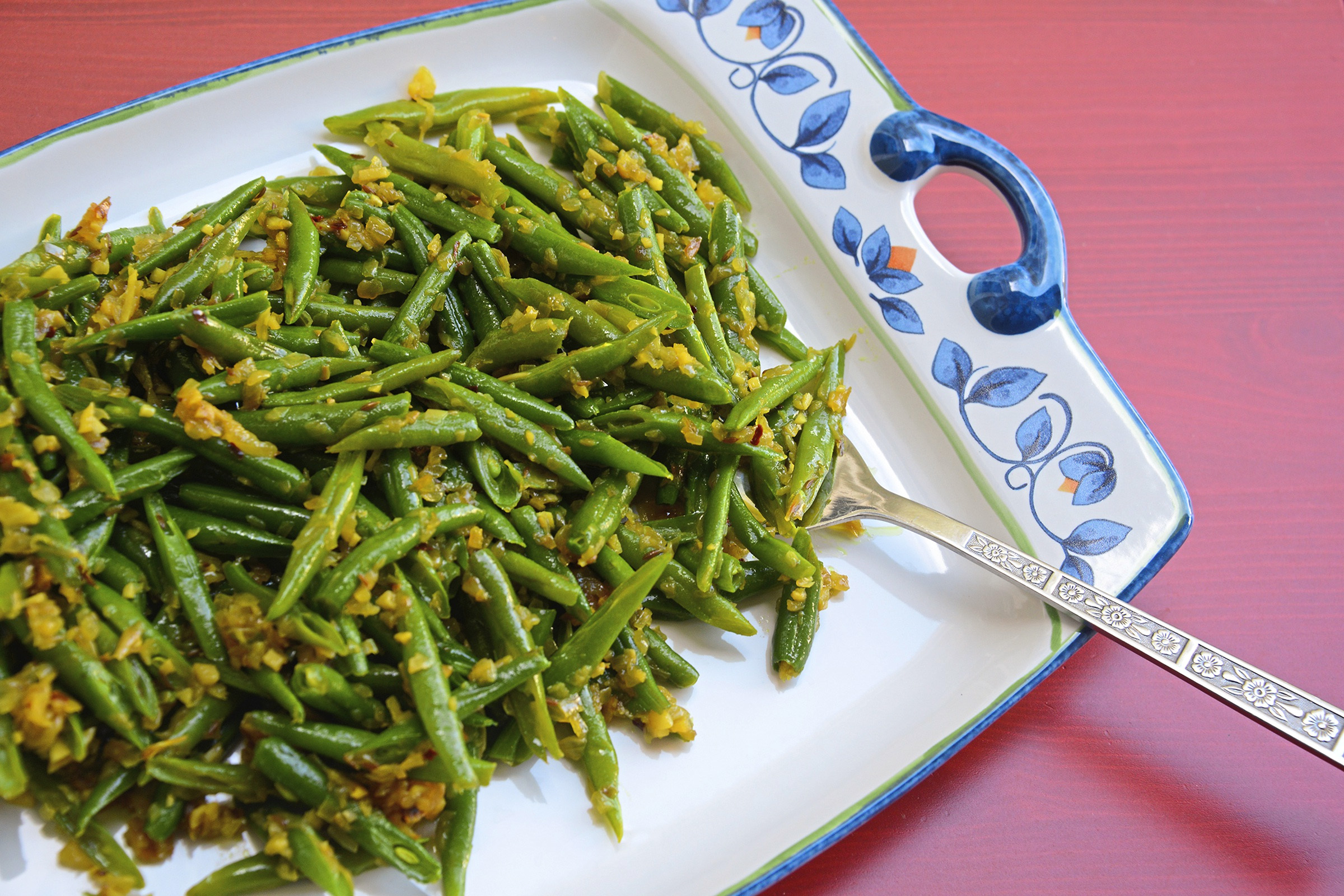 "20171101lf-Thanksgiving02-1 Green beans is spiced with green chili and red pepper flakes in the recipe from the cookbook, ""Rasika."""