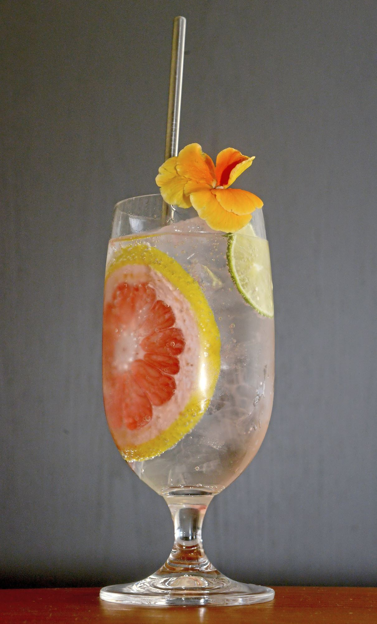 20171101ppTheWhale11MAG-1 A house gin and tonic with Bombay Sapphire gin, sugar, house tonic tincture and Natrona seltzer with a grapefruit and lime wheel prepared at or, The Whale in the Distrikt Hotel, Downtown.
