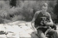 Bill Jeffcoat, a dog handler on his base in Vietnam, is shown here with his best friend, Fraulein.