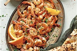 Shrimp with orange zest is topped with nigella seeds, also known as black onion seeds. Cumin seeds could be used instead of the nigella seeds.