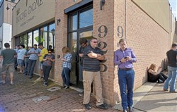 Patrons line up around the Dancing Gnome Brewing Company for the release of their new brew, Double Lustra Wednesday, October 11, 2017 in Sharpsburg.