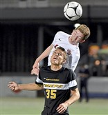 Peters Township's Nathan Lopus goes for a header against  North Allegheny's Josh Rouser Thursday night in the WPIAL Class 4A championship at Highmark Stadium.