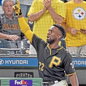 Andrew McCutchen comes out for his second curtain call of the night after hitting a three-run home run in the sixth inning against the Orioles on Sept. 26 at PNC Park.