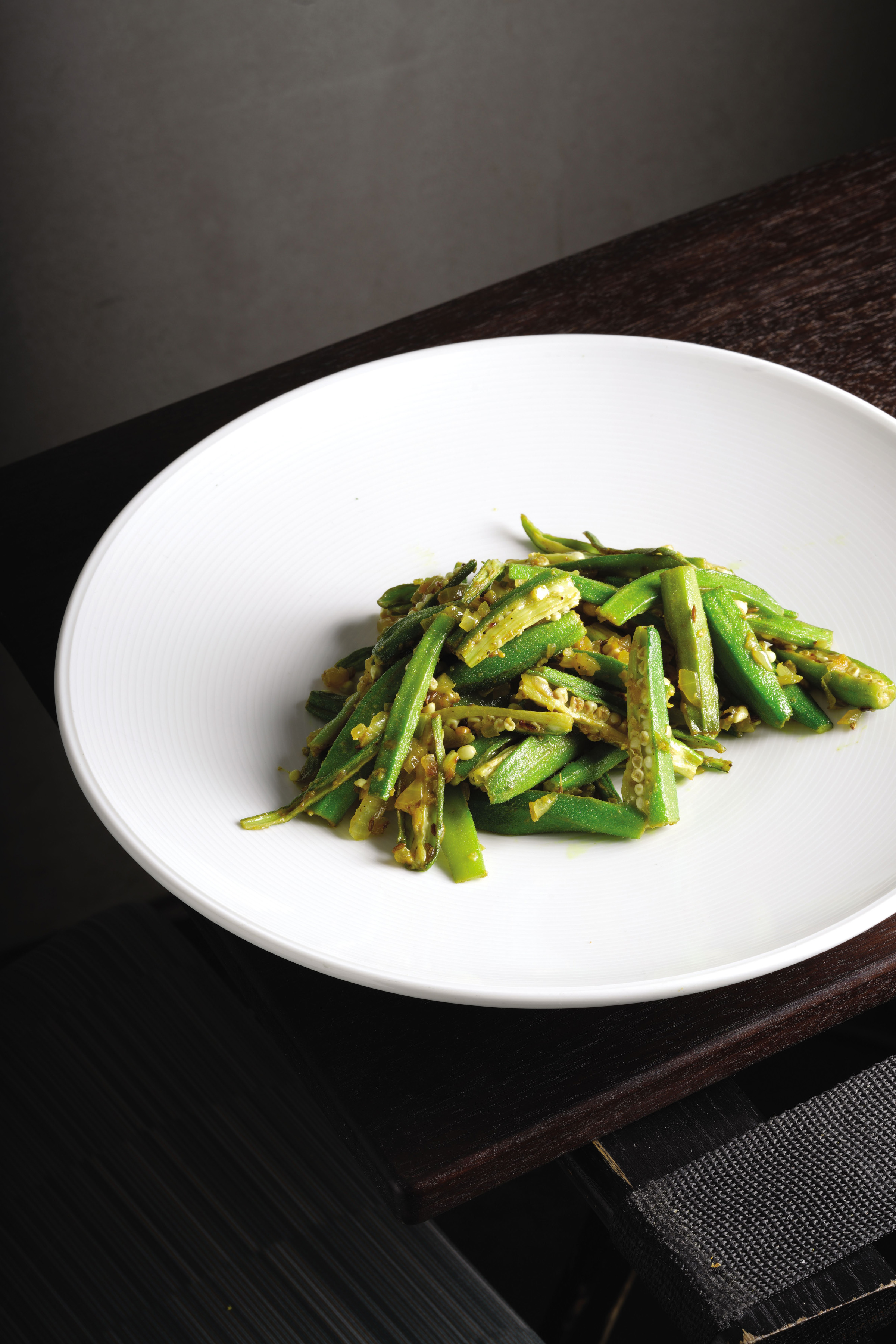 "GreenBean-1 Green beans is spiced with green chili and red pepper flakes in the recipe from the cookbook, ""Rasika."""