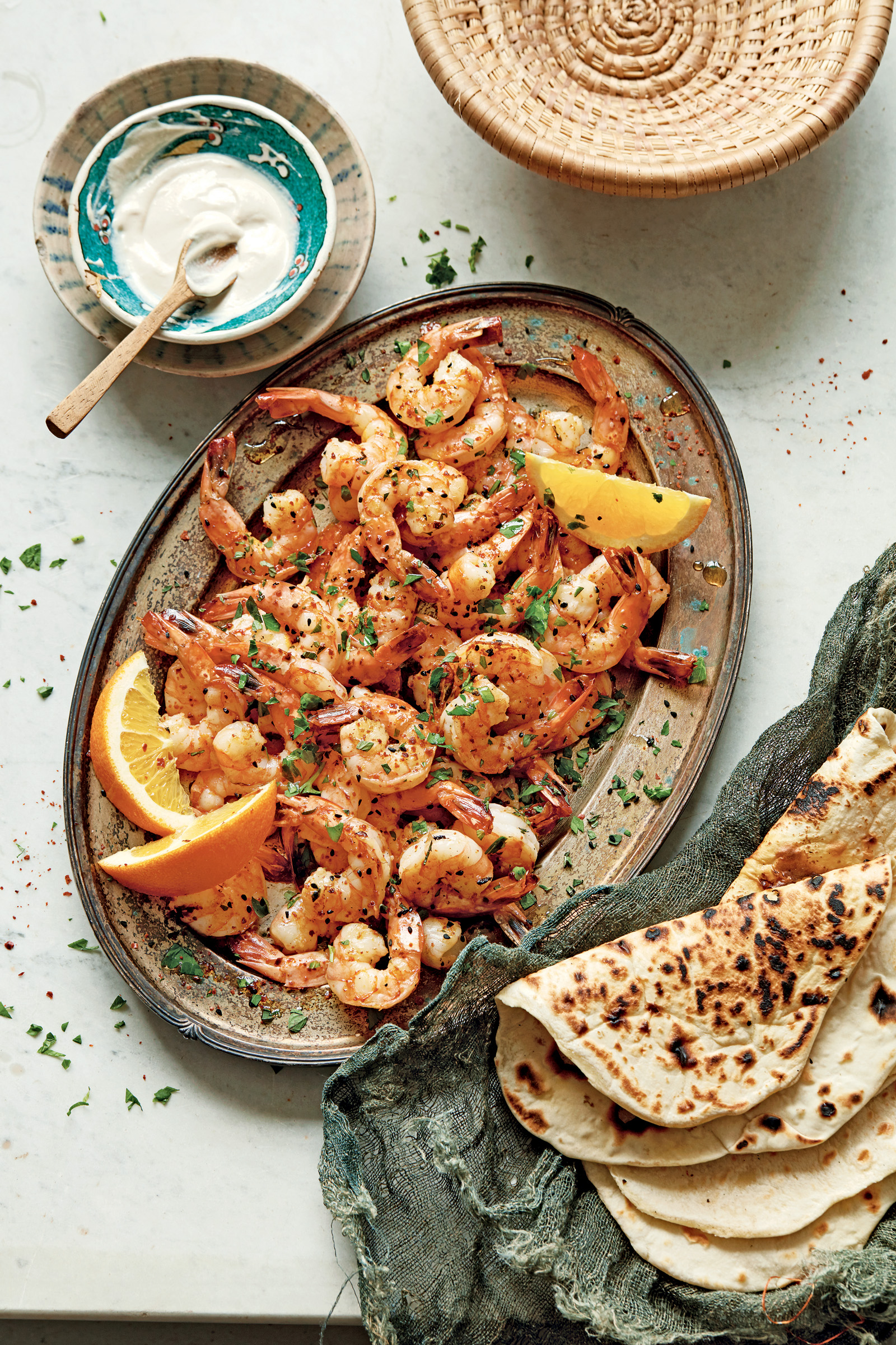 MARINATEDSHRIMP-2 Shrimp with orange zest is topped with nigella seeds, also known as black onion seeds. Cumin seeds could be used instead of the nigella seeds.