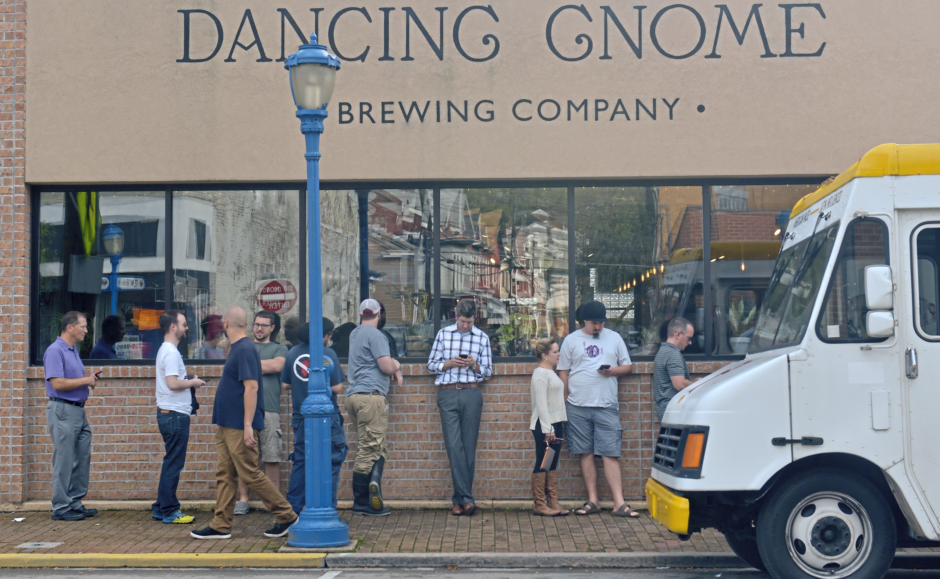 20171011ppDancingGnome2MAG-1 Patrons line up in front of the Dancing Gnome Brewing Company for the release of their new brew, Double Lustra Wednesday, October 11, 2017 in Sharpsburg.
