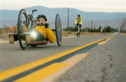 Attila Domos pilots his hand-cycle along the road in Borrego Springs, Calif.