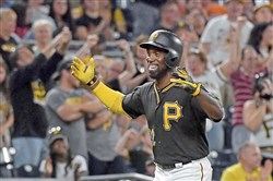Andrew McCutchen celebrates after hitting his first career grand slam in the second inning Sept. 26 against the Orioles at PNC Park.