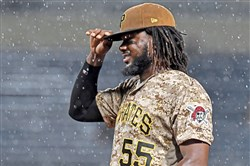 Pirates' Josh Bell looks through the raindrops during a game against the St. Louis Cardinals Aug. 17, 2017, at PNC Park.