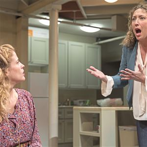 "Valeri Mudek, left, who plays Brigid, and Courtney Balan, who plays the sister Aimee, act out a scene during a rehearsal for the play, ""The Humans."""