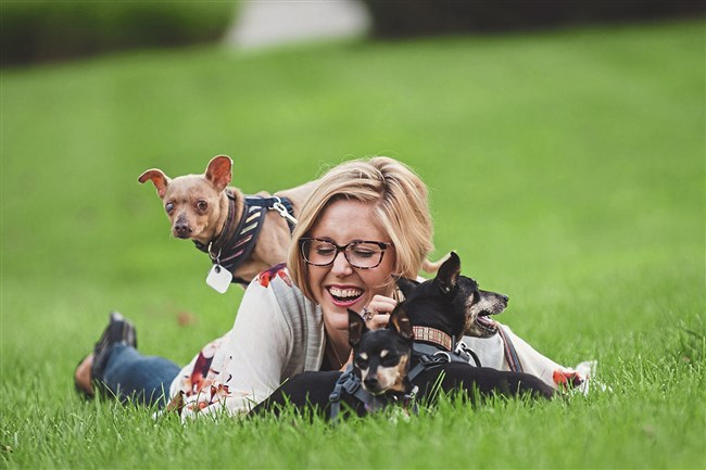 Dr. Colleen Krajewski with the Chihuahua she rescued from Puerto Rico and her two miniature pinschers.