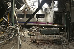 This Oct. 1, 2016, file photo provided by the National Transportation Safety Board shows damage from a Sept. 29, 2016, commuter train crash that killed a woman and injured more than 100 people at the Hoboken Terminal in Hoboken, N.J.