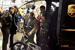"Nick Passaro, Three Rivers Division of UPS, puts the keys into UPS's first ""eBike"", for deliveries in downtown Pittsburgh and Manchester on Wednesday November 8, 2017.  To the left is Jessica Porter, ""eBike"" trainer & supervisor , and to the right is Andrew Trebesh."