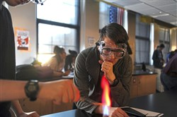 "Shane Cranor, 16, center,  and his partner Laim Hainsworth, 17, left, work on a chemistry project Wednesday, Nov. 8, 2017, in the ""College in High School"" classroom at Pittsburgh Public Schools' Science and Technology Academy in Oakland."