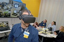 Johnny Diaz, an assistant manager trainee for Walmart, experiences Black Friday through virtual reality while his classmates view the video screen during a class for Walmart Academy at the Harrison store.