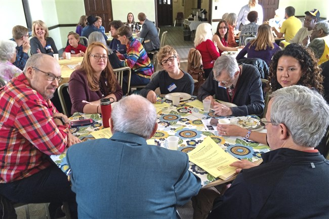 Intergenerational discussion groups gather around lunch tables at the East Liberty Presbyterian Church's  Great Exchange event.