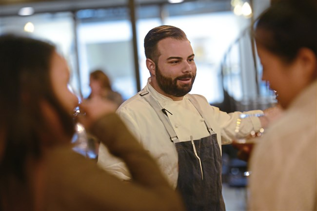 "Andrew ""Drew"" Garbarino, executive chef of the Bar Frenchman, talks with diners."