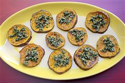 Sweet potatoes are roasted and dressed with an herby hazelnut gremolata.