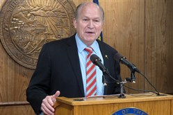 In this April 18, 2017, file photo, Alaska Gov. Bill Walker addresses reporters during a news conference in Juneau, Alaska.