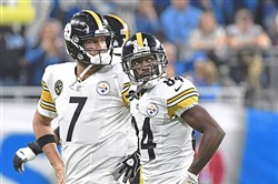 Ben Roethlisberger walks off the field with Antonio Brown.