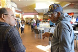 Timothy Price, left, of Verona and Charlie Seay of the East Hills chat after running into each other during a brunch for veterans Saturday at Rivers Casino on the North Side. The casino offered their brunch free to veterans. The men, who both served in the Army, went to grade school together.