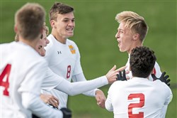 Cardinal Wuerl North Catholic's Ryan Augustine has had plenty to celebrate with his teammates after scoring the winning goals the past two matches.