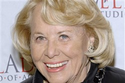 FILE- In this March 17, 2008, file photo, gossip columnist Liz Smith attends the 4th Annual Stella by Starlight benefit in New York. Smith, whose mixture of banter, barbs, and bon mots about the glitterati helped her climb the A-list as high as many of the celebrities she covered, has died. Literary agent Joni Evans told The Associated Press she died in New York on Sunday, Nov. 12, 2017. She was 94.