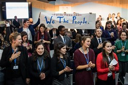 "People disturb an event titled ""The Role of Cleaner and More Efficient Fossil Fuels and Nuclear Power in Climate Mitigation"" with friendly singing at the COP 23 United Nations Climate Change Conference on November 13, 2017, in Bonn, Germany."